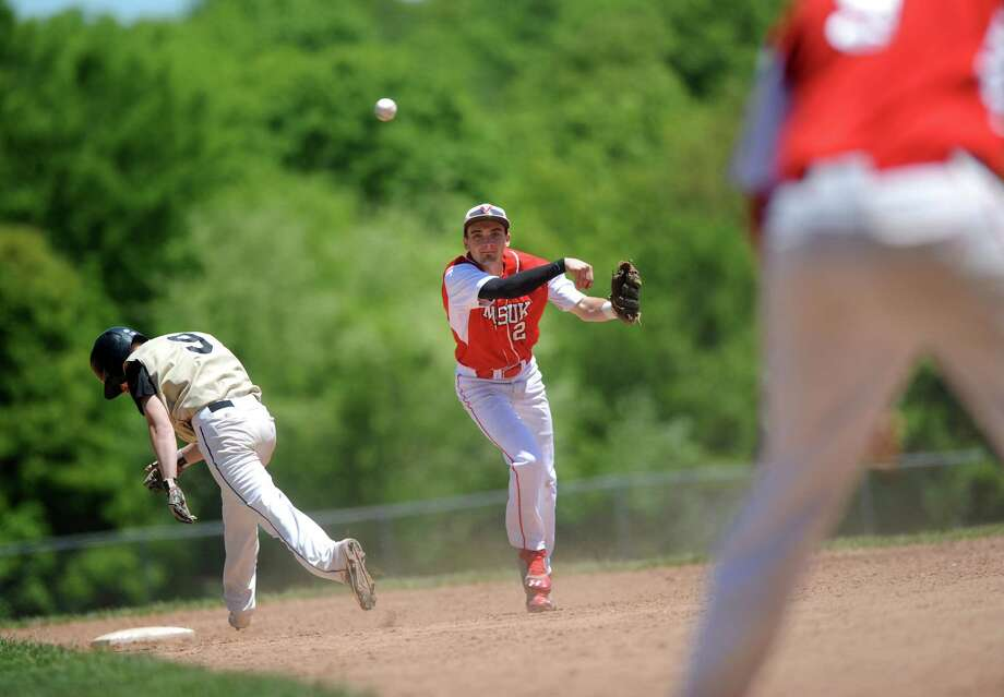 Masuk's Jay Buhlmann throws to first for a double play as Joel Barlow's Mark Raymond hangs his head Saturday, May 23, 2015, during their baseball game at Giampaolo Field in Monroe, Conn. Photo: Autumn Driscoll / Connecticut Post