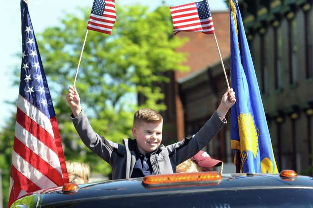 Jack Monahan waves flags as he rides in a truck representing VFW Post 358 during the Ballston Spa Memorial Day Parade on Saturday, May 23, 2015, in Ballston Spa, N.Y. (Cindy Schultz / Times Union) Photo: Cindy Schultz / 00031958A