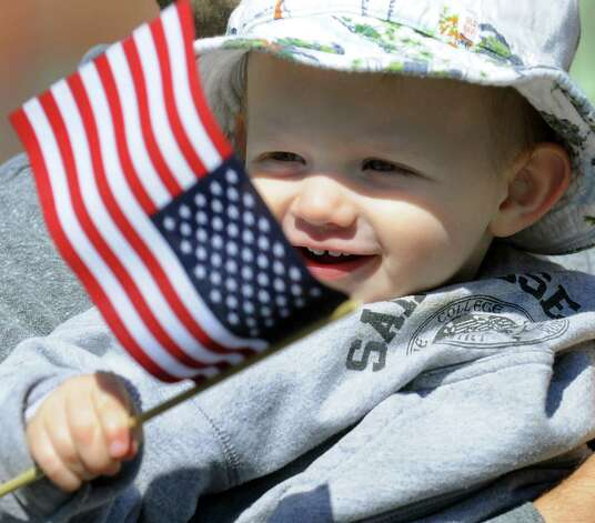Dean Buswell, 18 months, of Ballston Lake watches the Ballston Spa Memorial Day Parade on Saturday, May 23, 2015, in Ballston Spa, N.Y. (Cindy Schultz / Times Union) Photo: Cindy Schultz / 00031958A