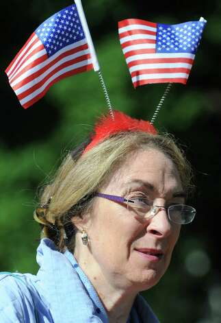 Judy Contompasis of Ballston Spa, who was born on Flag Day, sports a fitting headdress during the Ballston Spa Memorial Day Parade on Saturday, May 23, 2015, in Ballston Spa, N.Y. (Cindy Schultz / Times Union) Photo: Cindy Schultz / 00031958A