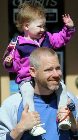 Grace Howe, 2, of Ballston Spa waves from her perch on the shoulders of her father, Justin Howe, during the Ballston Spa Memorial Day Parade on Saturday, May 23, 2015, in Ballston Spa, N.Y. (Cindy Schultz / Times Union) Photo: Cindy Schultz / 00031958A