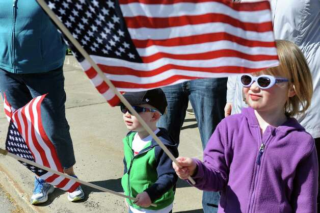 Kieran Whittemore, 4, of Ballston Spa, right, and her brother Henry Whittemore, 2, attend the Ballston Spa Memorial Day Parade on Saturday, May 23, 2015, in Ballston Spa, N.Y. (Cindy Schultz / Times Union) Photo: Cindy Schultz / 00031958A