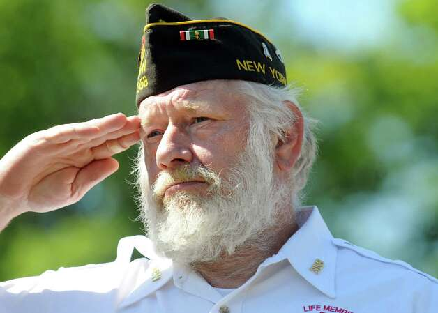 Gulf War veteran Michael Starks of VFW Post 358 salutes during a ceremony at the end of the Ballston Spa Memorial Day Parade on Saturday, May 23, 2015, in Ballston Spa, N.Y. (Cindy Schultz / Times Union) Photo: Cindy Schultz / 00031958A