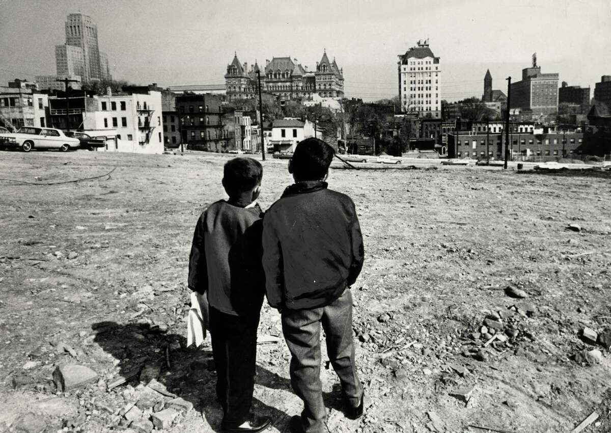 Two boys view a demolished block for construction of the South mall near the Cathedral of the Immaculate Conception Oct. 22, 1963, in Albany, N.Y. Historic Empire State Plaza, South Mall. (Times union archive) ORG XMIT: MER2014102219010648