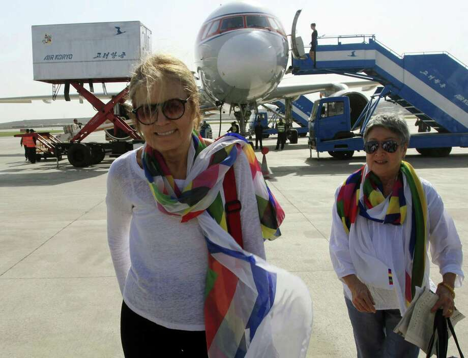 Activists Gloria Steinem, left, and Aiyoung Choi arrive Tuesday at Pyongyang Airport in North Korea. Steinem and a group of 29 other women from 15 countries are set to walk across the Demilitarized Zone dividing North and South Korea on Sunday after obtaining a rare green light from both governments. Photo: Jon Chol Jin, STF / AP