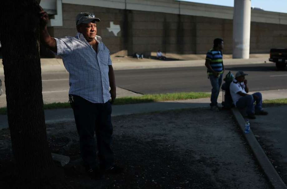 Antonio Garcia waits for a job at the corner of Westpark Drive and Southwest Freeway, a pickup point for day laborers. He says those workers here illegally are sometimes exploited. Photo: Mayra Beltran, Staff / © 2015 Houston Chronicle