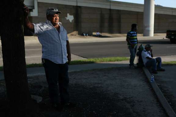 Antonio Garcia waits for a job at the corner of Westpark Drive and Southwest Freeway, a pickup point for day laborers. He says those workers here illegally are sometimes exploited.