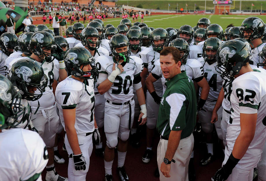 Reagan head coach David Wetzel talks to his team before a game against Madison Mavericks at Heroes Stadium in San Antonio on Oct. 13, 2012. Photo: Express-News File Photo / San Antonio Express-News