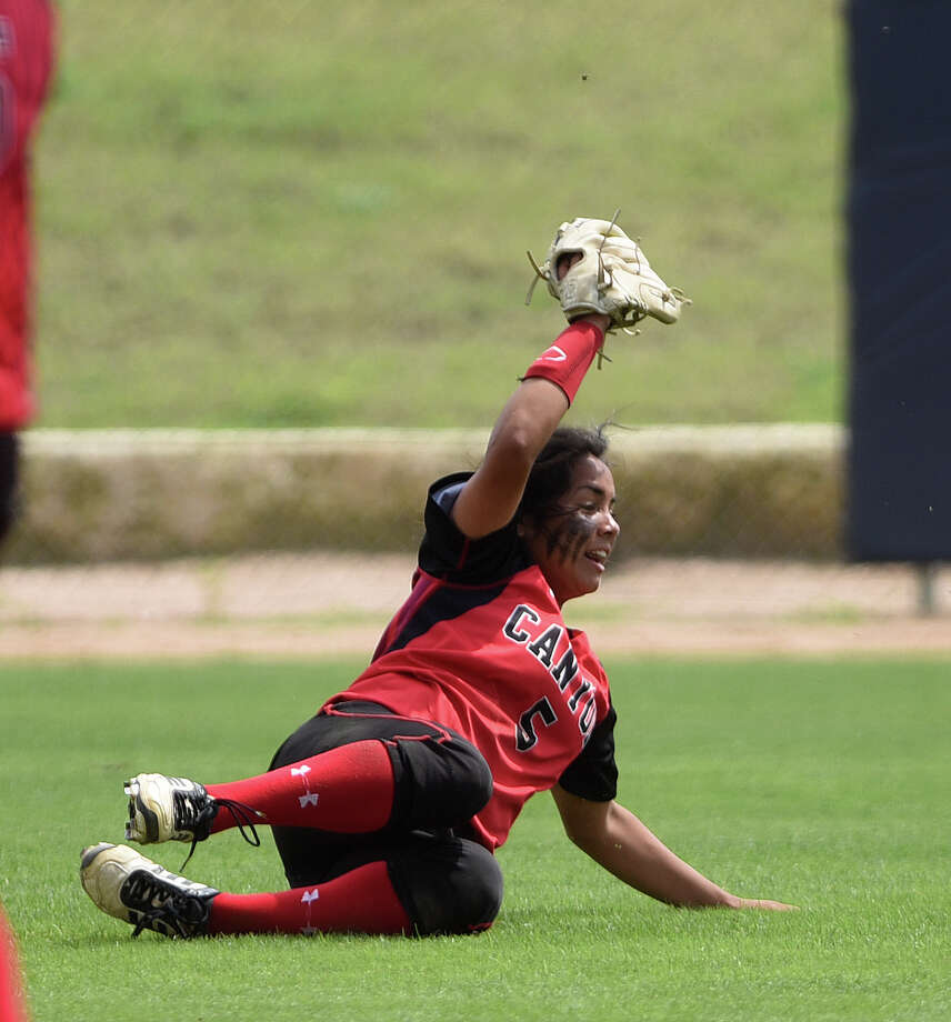 New Braunfels Canyon centerfielder Angelina Camacho makes a sliding catch against Eagle Pass during Game 2 of the Class 6A fourth-round softball series at St. Mary's University on Saturday, May 23, 2015. Photo: Billy Calzada /San Antonio Express-News / San Antonio Express-News