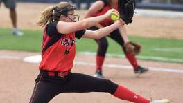 New Braunfels Canyon pitcher Brooke Vestal delivers against Eagle Pass during Game 2 of the Class 6A fourth-round softball series at St. Mary's University on May 23, 2015.