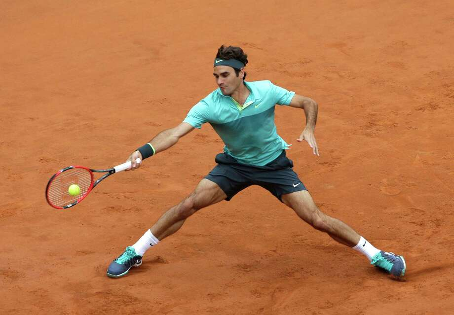 FILE - In this May 15, 2015, file photo, Roger Federer, of Switzerland, returns the ball to Tomas Berdych, of Czech Republic, during a quarterfinal match at the Italian Open tennis tournament in Rome. Federer will be competing in the 2015 French Open tennis tournament.  (AP Photo/Alessandra Tarantino, File) ORG XMIT: NY158 Photo: Alessandra Tarantino / AP