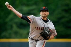 Long day produces doubleheader split for Giants - Photo