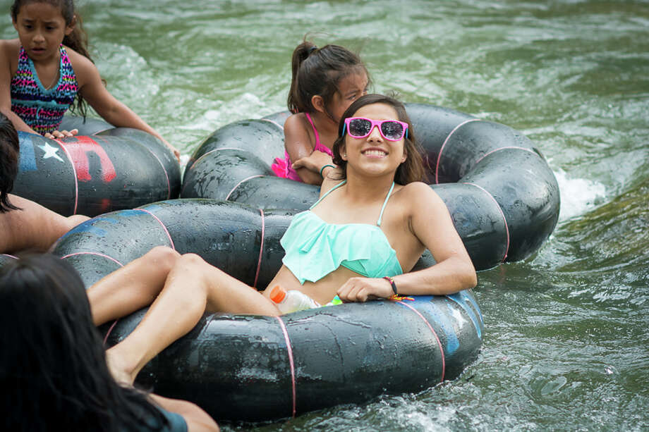 The threat of rain couldn't not stop these intrepid water enthusiasts from hitting the Comal River for some good old-fashioned Texas tubing.Click through to see some of the best places to tube in Texas, and suggestions for where to rent your gear! Photo: By Isaiah Matthews/Solarshot,  For MySA.com