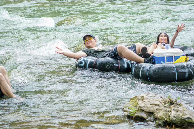 The threat of severe weather did not stop these intrepid water enthusiasts from hitting the Comal River for some old fashioned Texas tubing. Photo: By Isaiah Matthews/Solarshot, For MySA.com