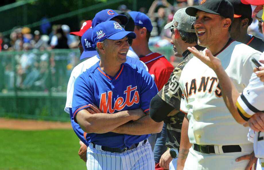 Former New York Mets player John Franco,left, and former San Francisco Giants player Russ Ortiz share a laugh  at the start of  the Hall Of Fame Classic baseball game at Doubleday Field in Cooperstown, N.Y., Saturday, May 23, 2015. (AP Photo / Steve Jacobs) ORG XMIT: NYGLE107 Photo: Steve Jacobs / 49835