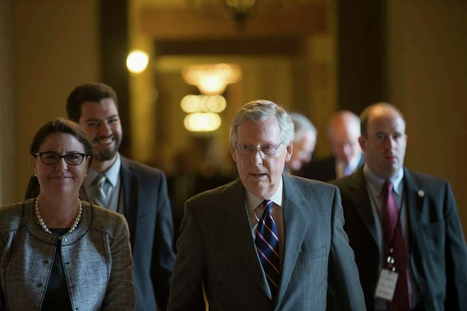 Senate Majority Leader Mitch McConnell (R-Ky.) heads to the Senate Chamber for a vote on Capitol Hill in Washington, May 22, 2015. On Saturday, Sen. Rand Paul, declared would not agree to extend the federal government's bulk collection of phone records program, forcing McConnell to order his colleagues back to Washington next Sunday to try again to prevent the act from expiring. (Zach Gibson/The New York Times) ORG XMIT: XNYT11 Photo: ZACH GIBSON / NYTNS