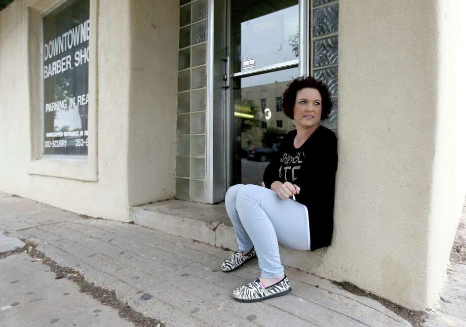 "Becky Olson, of Stanton, a stylist at the Downtowner Barber Shop, takes a break in Big Spring. ""(Jade Helm) has not bothered me at all,"" said Olson. Photo: Gary Coronado, Staff / © 2015 Houston Chronicle"