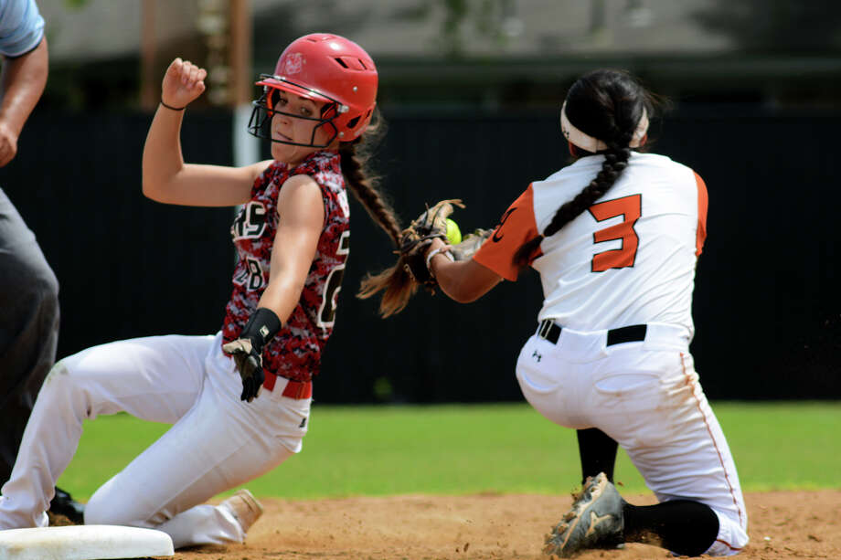 Katy's McKay Bloxham avoids the tag from Alvin shortstop Marisa Sosa in the fourth inning of Katy's 8-2 win in Saturday's Class 6A Region III softball playoff game at Alvin. Photo: Jerry Baker, Freelance