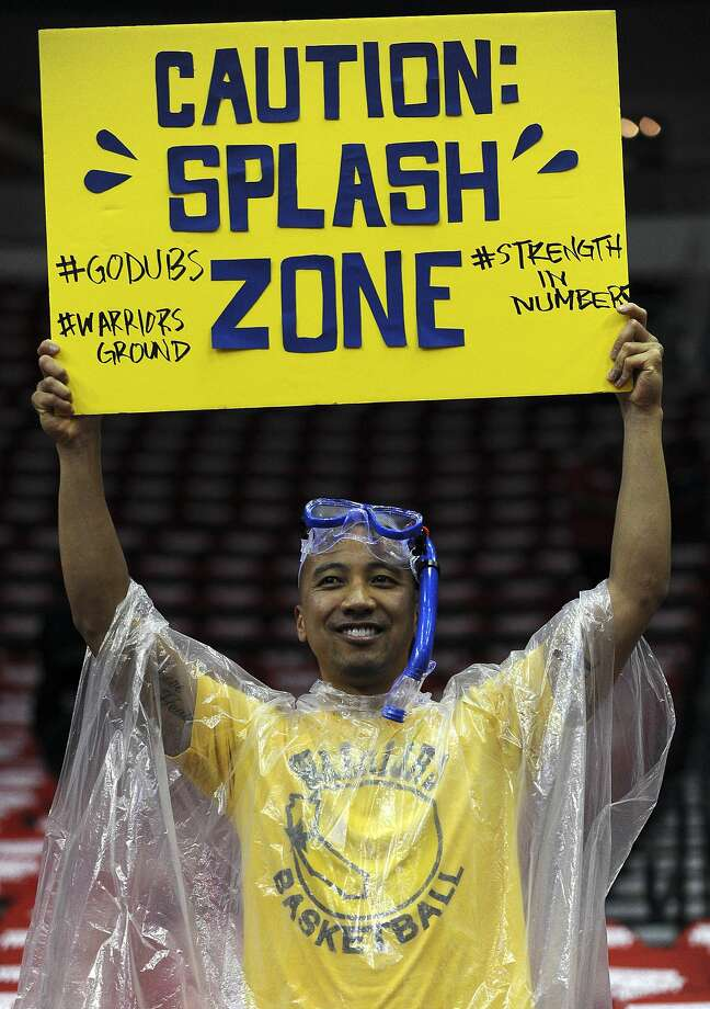 Golden State Warriors fan Angelo Macugay of San Francisco, CA. displays a sign supporting Golden State Warriors guard Stephen Curry #30 and Golden State Warriors guard Klay Thompson #11before Game 3 of the Western Conference Finals against the Houston Rockets, Saturday, May 23, 2015, at Toyota Center in Houston, TX. (Photo: Eric Christian Smith/Special to the Chronicle) Photo: Eric Christian Smith, Special To The Chronicle