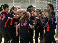 Stamford's Lauren O'Neill is surrounded by teammate after hitting a home run, during softball action against Norwalk in Stamford, Conn., on Saturday May 23, 2015.