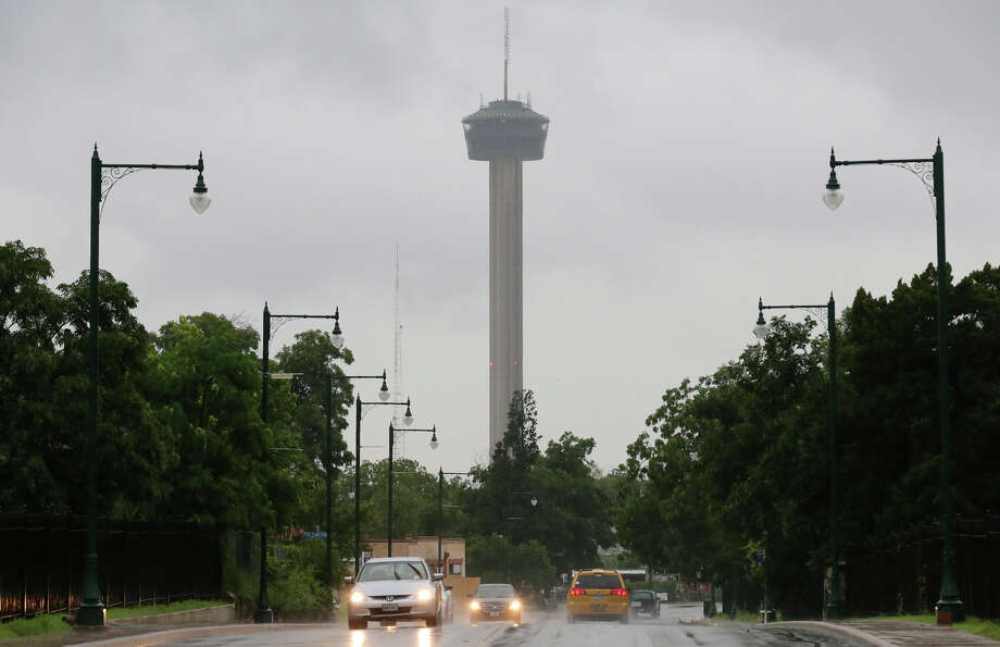 A view of gray skies around the Tower of the Americas Saturday May 30, 2015 as storms move through the area. Photo: Edward A. Ornelas, San Antonio Express-News / © 2015 San Antonio Express-News