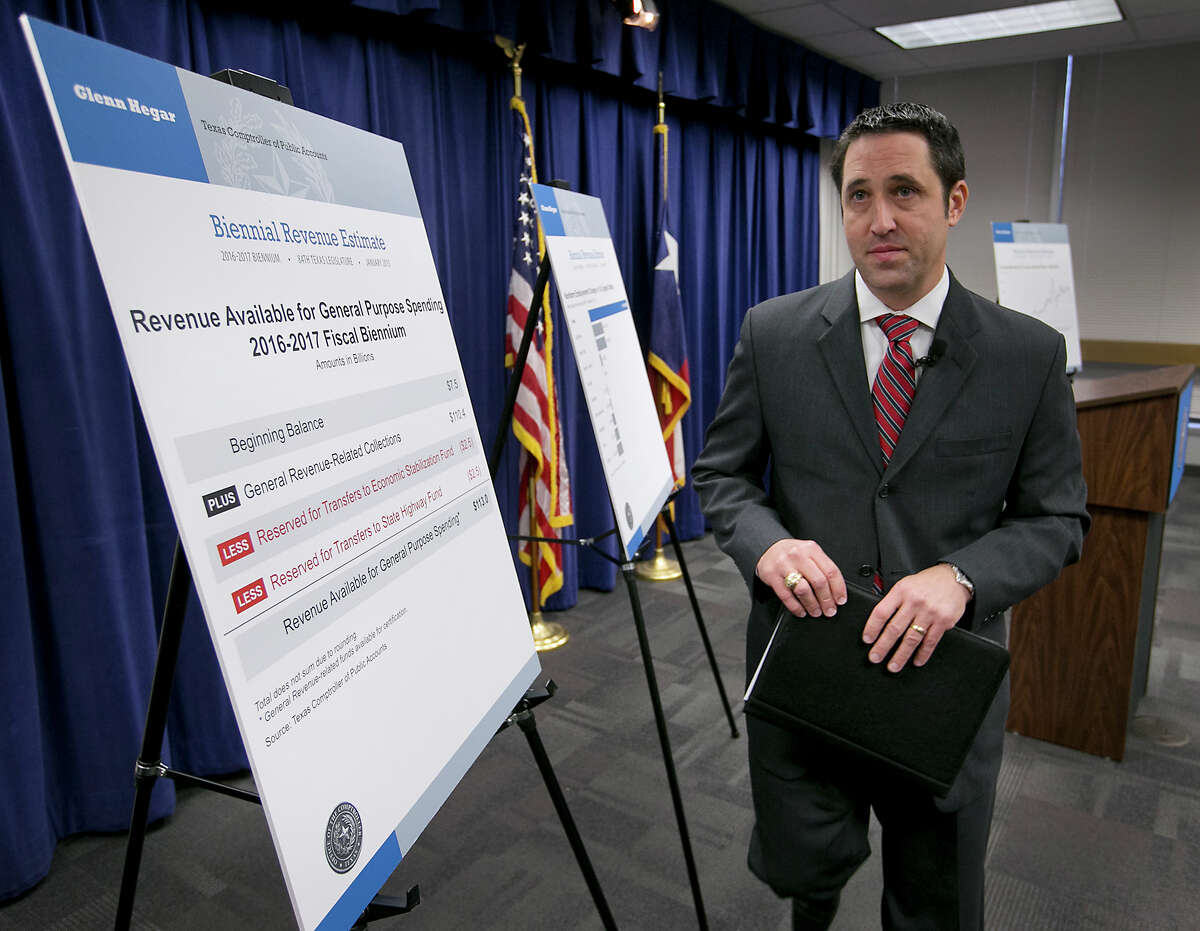 Texas State Comptroller Glenn Hegar announces an overwhelmingly Republican Legislature will have $113 billion in revenue to spend over the next two years, at an announcement made on Monday, Jan. 12, 2015, in Austin, Texas, the day before the 84th legislature is sworn into office. (AP Photo/Austin American-Statesman, Ralph Barrera) AUSTIN CHRONICLE OUT, COMMUNITY IMPACT OUT, INTERNET AND TV MUST CREDIT PHOTOGRAPHER AND STATESMAN.COM, MAGS OUT