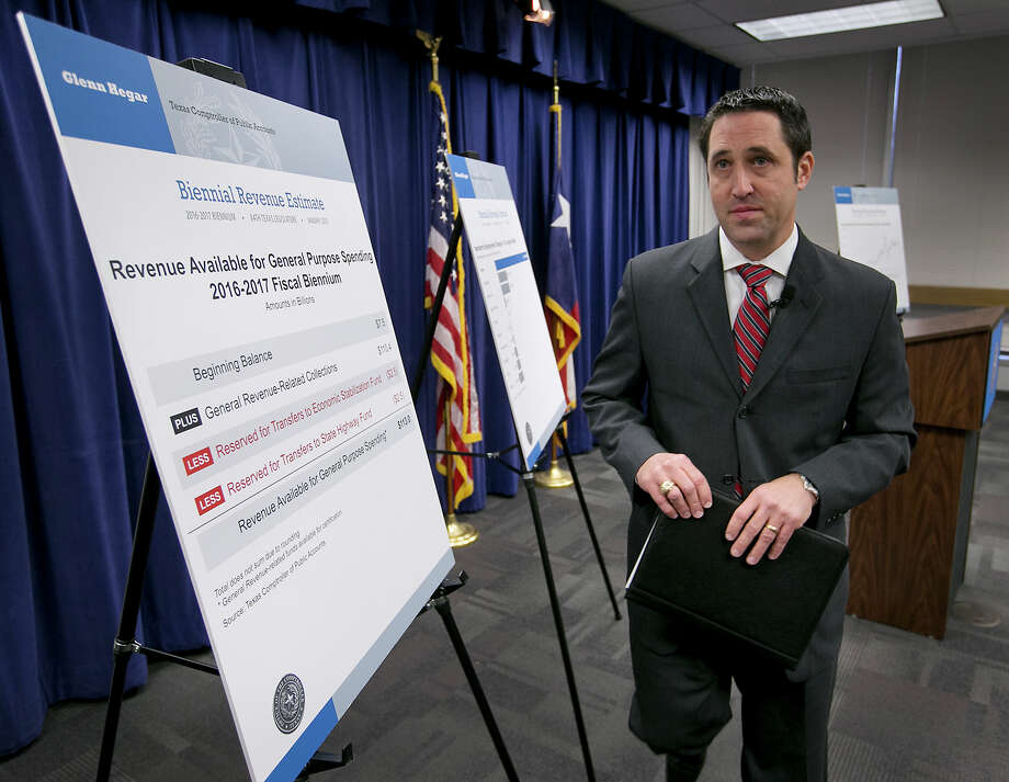 Texas State Comptroller Glenn Hegar announces an overwhelmingly Republican Legislature will have $113 billion in revenue to spend over the next two years, at an announcement made on Monday, Jan. 12, 2015, in Austin, Texas, the day before the 84th legislature is sworn into office. (AP Photo/Austin American-Statesman, Ralph Barrera)  AUSTIN CHRONICLE OUT, COMMUNITY IMPACT OUT, INTERNET AND TV MUST CREDIT PHOTOGRAPHER AND STATESMAN.COM, MAGS OUT Photo: Ralph Barrera, MBO / Austin American-Statesman