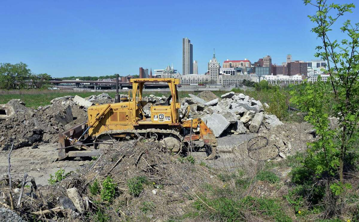 The vacant waterfront lot where Rensselaer High School once stood with the skyline of Albany beyond Thursday May 7, 2015 in Rensselaer, NY. (John Carl D'Annibale / Times Union)
