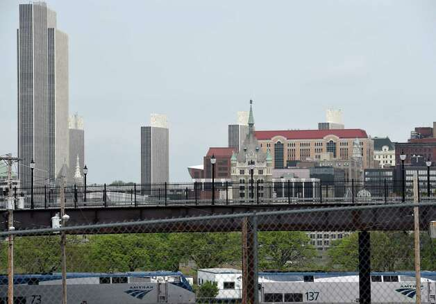 The Albany skyline is framed by the Broadway bridge Tuesday morning May 12, 2015 in Rensselaer, N.Y.    (Skip Dickstein/Times Union) Photo: SKIP DICKSTEIN / 00031793A