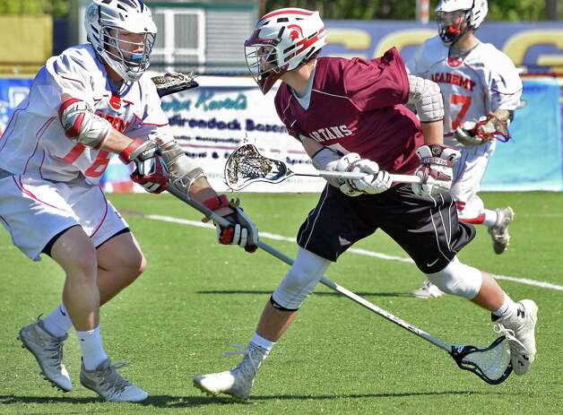 Burnt Hills' #Max Charlton, right, gets his shot past Albany Academy's #16 Mike Bohl to score in the Section II Class B boys' lacrosse final at John Fallon Field Saturday May 23, 2015, in Albany, NY. (John Carl D'Annibale / Times Union) Photo: John Carl D'Annibale / 00031878A