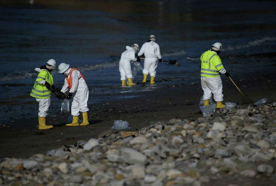 Workers continue to clean oil from Refugio State Beach on Saturday  in Goleta, Calif. A  state of emergency was declared as  100,000 gallons of oil spilled from an abandoned pipeline. Photo: Justin Sullivan /Getty Images / 2015 Getty Images