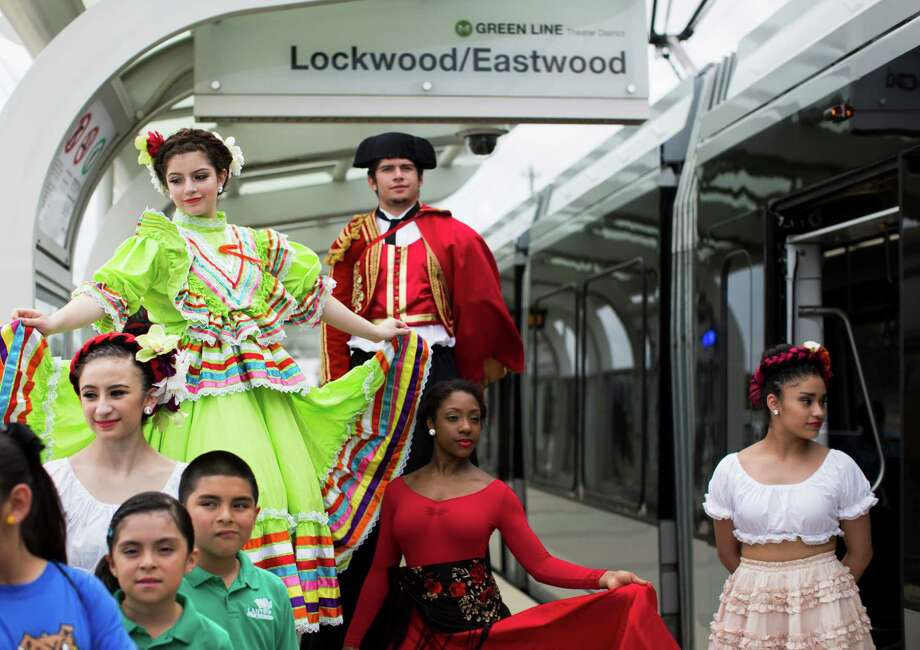 From top left, Lauren Martinez, 15, Chris Martinez, 22, Allana Brown, 17, and Maria Perez, seen at Lockwood-Eastwood rail stop wearing performance clothes, helped to inaugurate the MetroRail Green and Purple Lines on May 23. Photo: Marie D. De Jesus, Staff / © 2015 Houston Chronicle