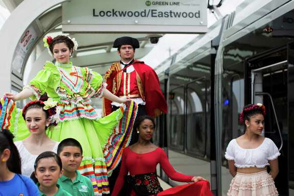 From top left, Lauren Martinez, 15, Chris Martinez, 22, Allana Brown, 17, and Maria Perez, seen at Lockwood-Eastwood rail stop wearing performance clothes, helped to inaugurate the MetroRail Green and Purple Lines on May 23.