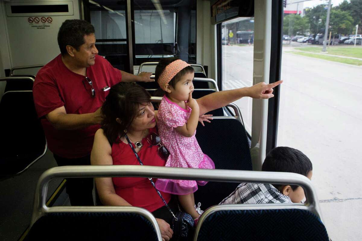Jose Trevino and his wife Judith Trevino with Ariel Dean and Leonidas Dean, take a ride on the new Green Line Metro to look at the different neighborhoods of Houston from the Metro before heading to RailFest.