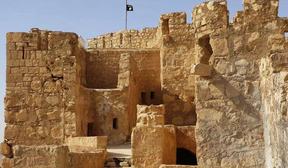 Islamic State militants released a photo of their black flag raised over Palmyra's hilltop Islamic-era castle, a structure hundreds of years old. Photo: Uncredited, HONS / The website of Islamic State