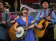 Members of Pickled Okra perform onstage during the 44th annual Northwest Folklife Festival at the Seattle Center on Saturday, May 23, 2015.
