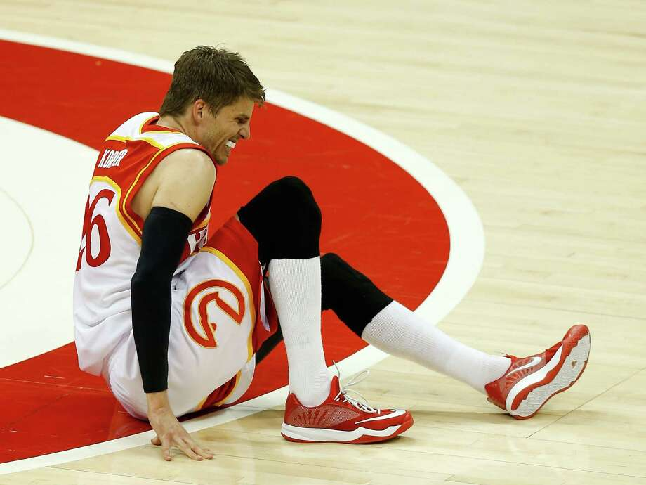 Kyle Korver goes down during Game 2 on Friday with what later was diagnosed as a severe high-ankle sprain. The Hawks guard has been ruled out for the remainder of the playoffs. Photo: Mike Zarrilli, Stringer / 2015 Getty Images