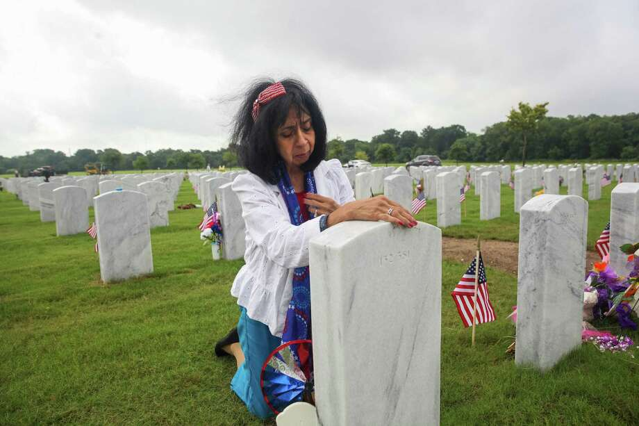 """Maria Velasquez Miller visits the grave of her husband, retired Tech. Sgt. James Miller, at Fort Sam Houston National Cemetery. """"If I don't die of a heart attack, I will die of a broken heart. I miss him so much,"""" she said. Photo: Photos By Julysa Sosa /For The San Antonio Express News / Julysa Sosa For the San Antonio Express-News"""