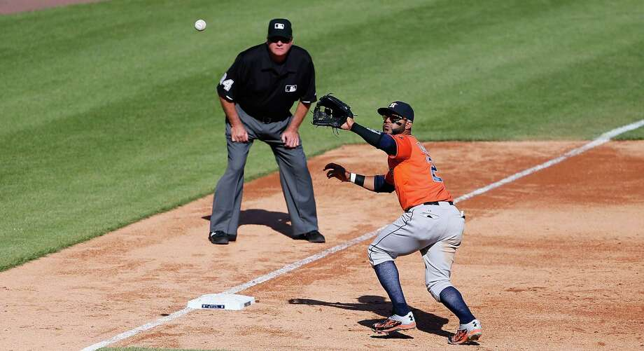 The Astros knew the Tigers' Ian Kinsler likes to pull the ball down the third-base line, so with men on first and second and no outs, Jonathan Villar, above, was ready. He speared Kinsler's smash, stepped on third and threw to Jose Altuve at second. Altuve relayed to Chris Carter at first to retire Kinsler, and quick as a hiccup, the bases were empty and rookie starter Lance McCullers Jr. had something to tell his grandchildren. Photo: Leon Halip, Stringer / 2015 Getty Images
