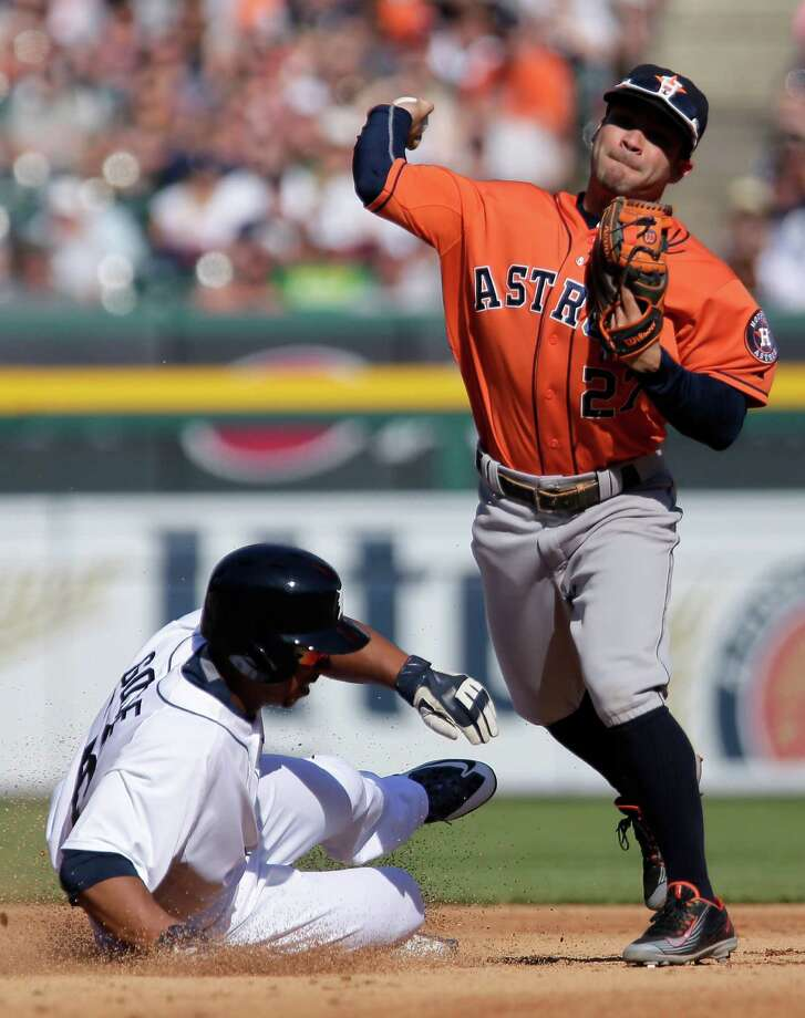 Houston Astros second baseman Jose Altuve (27) gets the force out on Detroit Tigers' Anthony Gose for the second out of a triple play during the fifth inning of a baseball game Saturday, May 23, 2015, in Detroit. Detroit's Ian Kinsler hit to Houston third baseman Jonathan Villar who stepped on the bag to get Detroit's Hernan Perez and start the triple play. (AP Photo/Duane Burleson) ORG XMIT: DTS104 Photo: Duane Burleson / FR38952 AP
