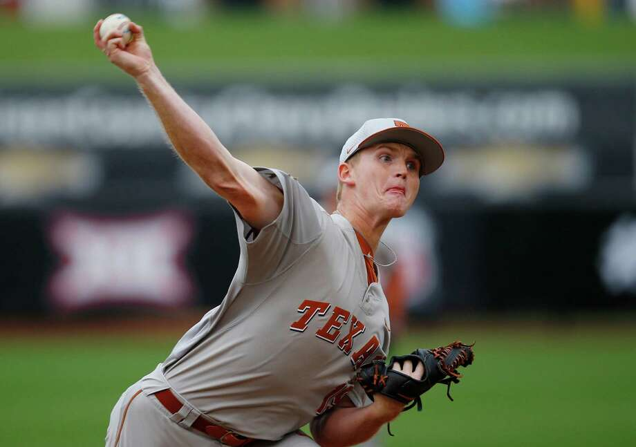 Connor Mayes tossed a two-hitter to lift Texas to a 4-0 win over Baylor and into the Big 12 tournament championship game, where the Longhorns will face Oklahoma State. Photo: Sue Ogrocki, STF / AP