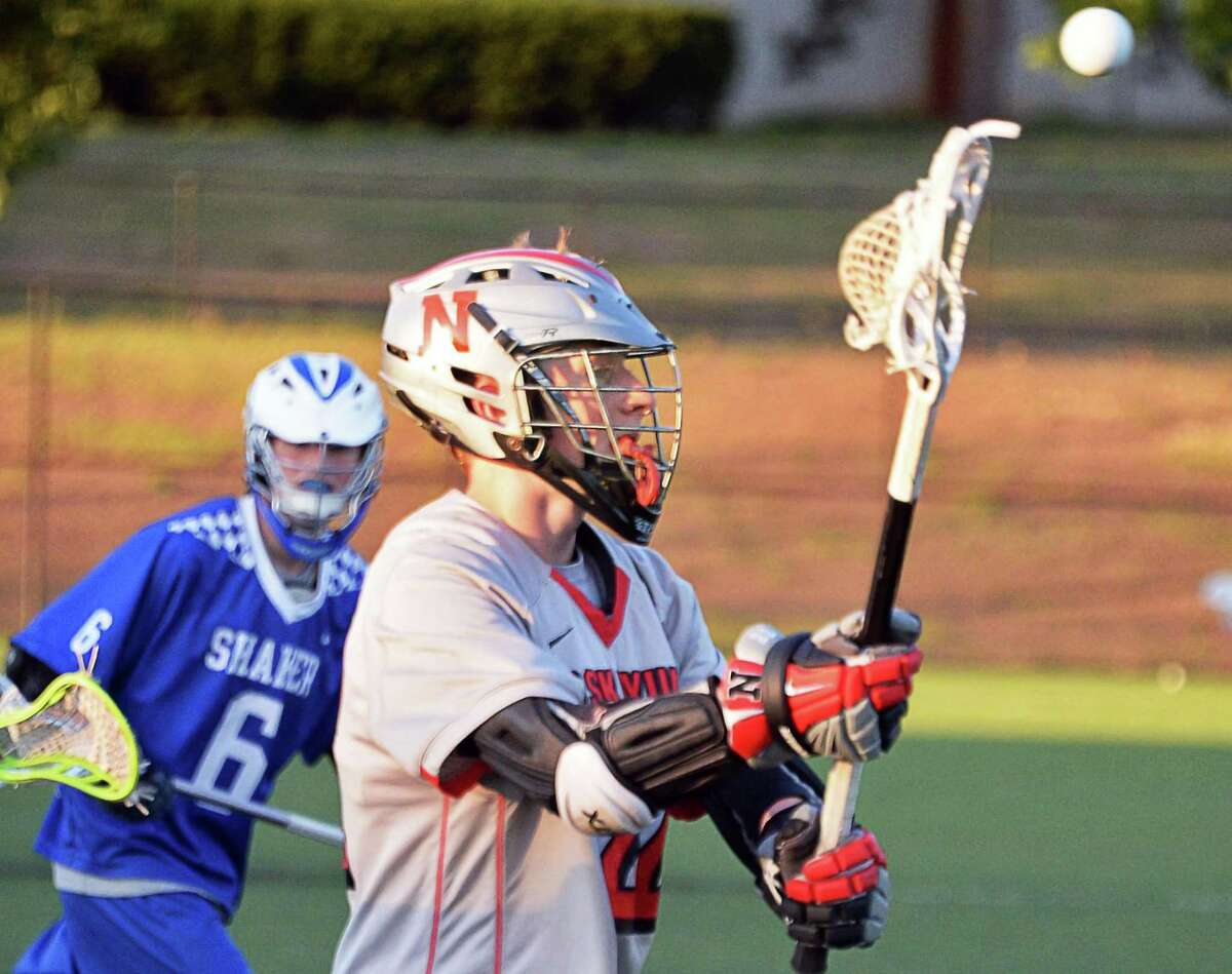 Niskayuna's #22 James Sexton, right, passes during the Section II Class A boys' lacrosse final against Shaker at John Fallon Field Saturday May 23, 2015, in Albany, NY. (John Carl D'Annibale / Times Union)(John Carl D'Annibale / Times Union)