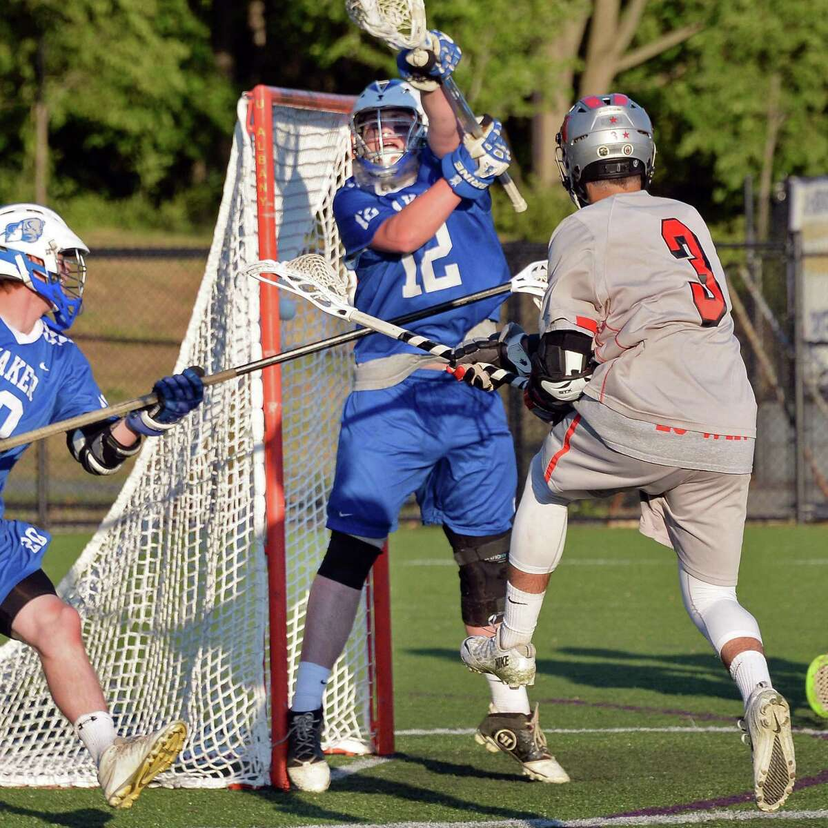 Niskayuna's #3 Evan Maloney, right, scores against Shaker goalie #12 Andrew Leahey during their Section II Class A boys' lacrosse final at John Fallon Field Saturday May 23, 2015, in Albany, NY. (John Carl D'Annibale / Times Union)(John Carl D'Annibale / Times Union)