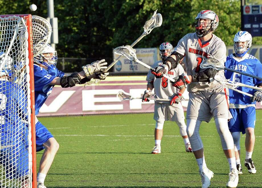Niskayuna's #1 Aidan Byrne scores against Shaker goalie #12 Andrew Leahey during their Section II Class A boys' lacrosse final at John Fallon Field Saturday May 23, 2015, in Albany, NY. (John Carl D'Annibale / Times Union)(John Carl D'Annibale / Times Union) Photo: John Carl D'Annibale / 00031877A