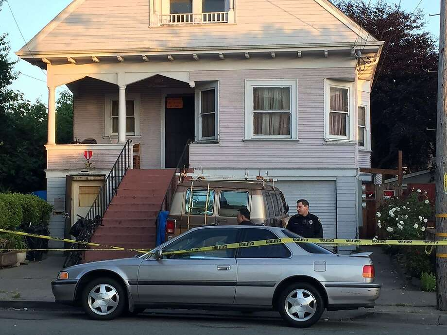 The home on 54th Street in North Oakland where police found the bodies of three men shot to death on May 23, 2015. A suspect has been detained. Photo: Henry K. Lee, San Francisco Chronicle