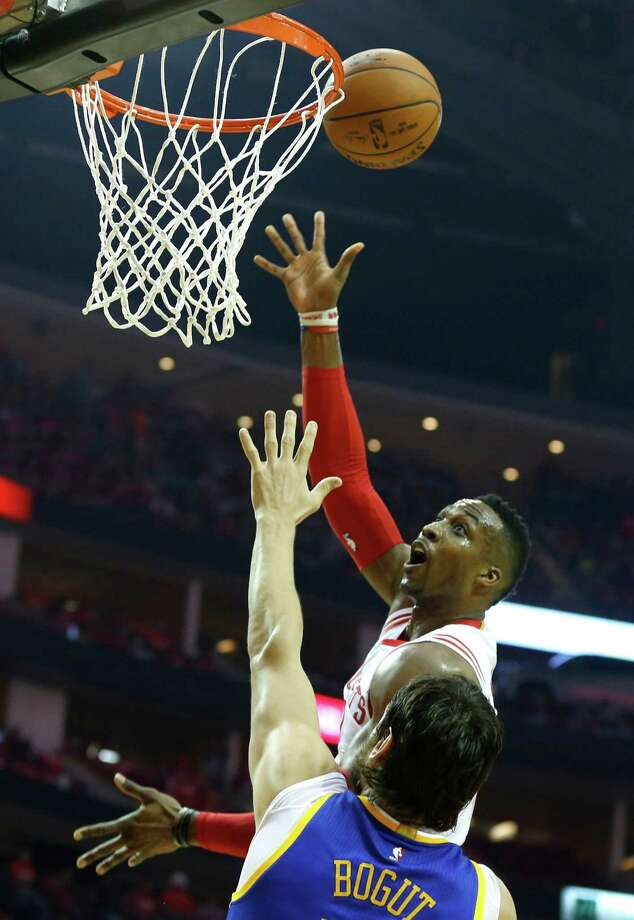 Dwight Howard goes up and over Andrew Bogut on Saturday at Toyota Center. Photo: James Nielsen, Staff / © 2015  Houston Chronicle