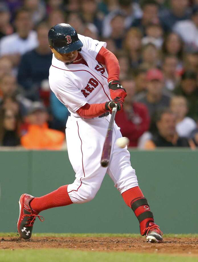 BOSTON, MA - MAY 23:  Mookie Betts #50 of the Boston Red Sox drives in the tying run against the Los Angeles Angels in the third inning at Fenway Park on May 23, 2015 in Boston, Massachusetts. (Photo by Jim Rogash/Getty Images) ORG XMIT: 538580893 Photo: Jim Rogash / 2015 Getty Images