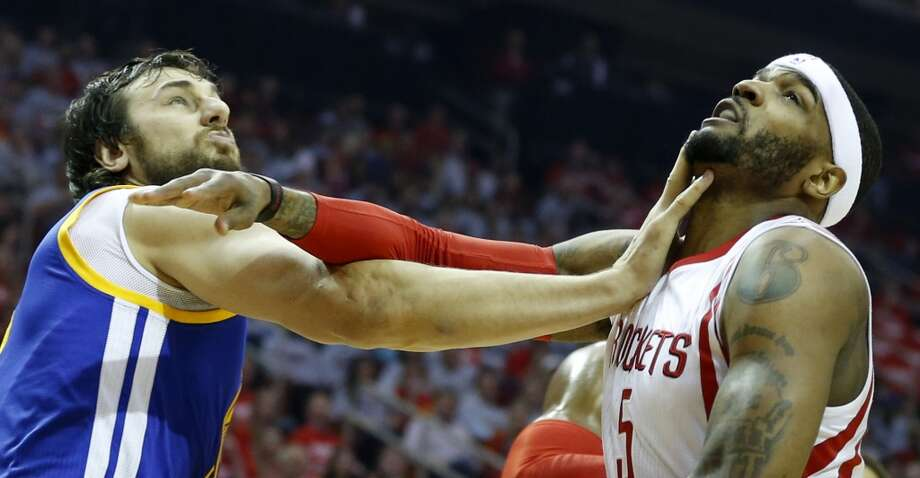 Golden State Warriors center Andrew Bogut (12) and Houston Rockets forward Josh Smith (5) get tangled up under the basket during the first quarter of Game 3 of the NBA Western Conference finals at the Toyota Center on Saturday, May 23, 2015, in Houston.  ( James Nielsen / Houston Chronicle ) Photo: Houston Chronicle