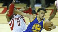 Golden State Warriors guard Stephen Curry (30) pulls a rebound away from Houston Rockets center Dwight Howard (12) during the first half of Game 3 of the NBA Western Conference Finals at Toyota Center on Saturday, May 23, 2015, in Houston. ( Karen Warren / Houston Chronicle )