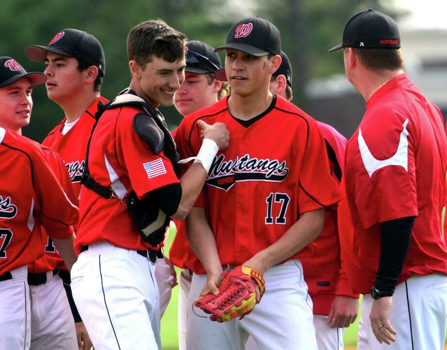 Fairfield Warde's Reece Maniscalco (17) celebrates a no hitter with his teammates and catcher John Natoli, during baseball action against Trumbull in Trumbull, Conn., on Wednesday May 20, 2015. Photo: Christian Abraham / Connecticut Post
